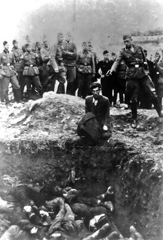A member of Einsatzgruppe D is just about to shoot a Jewish man kneeling before a filled mass grave in Vinnitsa, Ukraine, in 1941.