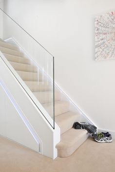 A clean, modern and minimalistic staircase, complete with programmable LED multi-coloured lights. A clean, modern and minimalistic staircase, complete with programmable LED multi-coloured lights. House Staircase, Staircase Railings, Staircase Design, Banisters, Staircases, Glass Stairs, Glass Railing, Glass Bannister, Glass Stair Balustrade