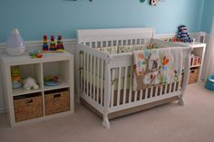 We wanted to have a gender neutral nursery since we did not find out the sex of our baby before birth. However, we also wanted to have something colorful - going beyond your standard beiges, greens and yellows. We found this to be very hard to find examples of that didn't skew too much boy or girl. Then I saw the Skip Hop bedding and knew it was the perfect color palette for our colorful nursery. We used a slightly lighter shade of the blue found in the bedding as the wall color. We love ...
