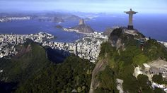 Aerial view of Rio de Janeiro with Christ Redeemer and Corcovado Mountain. Description from dreamstime.com. I searched for this on bing.com/images