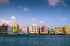 Curacao....houses painted in Caribbean colors...teal, yellow, coral, blue, pink.....click to enlarge to appreciate it more