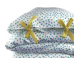 ORGANIC Toddler Bedding set - Scattered dots - peacock blue dots on white background. $139.00, via Etsy.