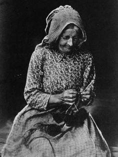 Old woman knits. circa 1897.