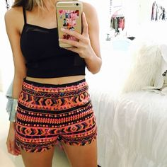 Colorful Beaded Shorts Inspired by the widely popular Aztec print these beautifully embellished shorts are careful beaded to perfection! The pops of color assist in combining timeless style with fashion forward designs to add a twist to any go-to blouse.  •Intact embellishment •Front/back beading  •Features a mix of colors such as hot pink, pink, orange, blue, and yellow •Gently used in great condition •No flaws/imperfections Shorts