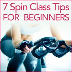 Woman on a cycle bike with the words 7 Spin Class Tips For Beginners