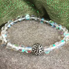 The focal point of this bracelet is a beautiful hand poured intricately designed pewter bead from Wales. It is surrounded by Spectrolite Quartz that has a luminous, colorful glow. This bracelet is so pretty when stacked with others!
