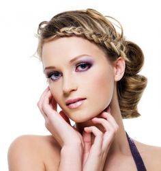Hairstyle with upswept hair and braids on the front