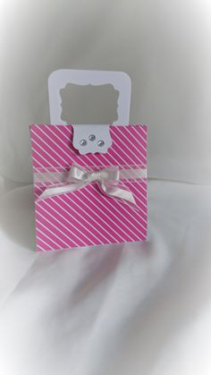 """A beautiful handmade handbag shaped gift bag. Made from quality card stock and designer series paper.    You can easily fit in two bottles of nail varnish, small hand cream,miniature perfume etc (shown in pictures but not included in sale)    (Folds flat for posting)    Measures 4.25"""" wide 4.5"""" height (not including handle) and approx 2"""" depth 