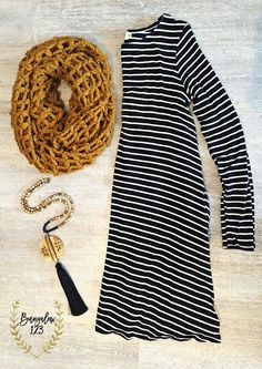 """Black & White striped A-line Jersey Dress that works well for multi-seasonal wear. 60% Poly 40% Cotton. Shown with the Pierside Scarf in Mustard and the Jasper/Black Tassel Necklace. Small - 34.5"""" fro"""