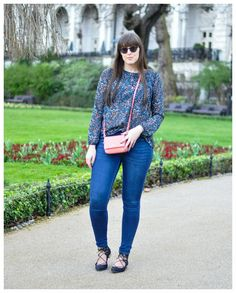 This outfit on repeat - jeans a ditzy floral blouse and a cute little bag.