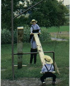sweet Amish boys ~ love the one helping :)