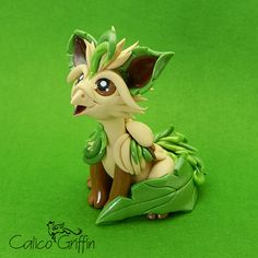 Leaffin the Pokegriff - clay sculpture - Premo Sculpey polymer figurine sculpture dragon gryphon beige green grass