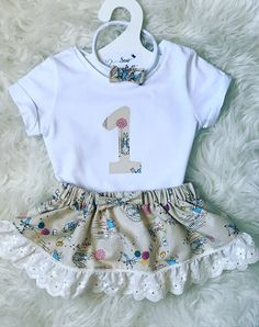 Beautiful Beatrix Potter/peter Rabbit Birthday set. • Elasticated skirt with bow and trim. • T-Shirt with birthday Number in matching fabric. • Headband with matching bow. You can choose your clothing size at check out. Currently comes with a long sleeve vest for Autumn/Winter. If you