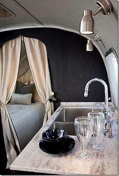 RV in style- great idea when you have two people in two separate beds in you're itty bitty camper!