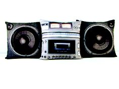 Boombox Pillow Set / Available from Meninos is the perfect place to rest your head. Set includes two speaker pillows and a middle boombox pillow that can be washed without fear of the images fading. Far better than the throw pillows your girlfriend is trying to talk you into getting. Now, instead of odd nightmares, you can doze off and dream of Hammer pants and Adidas tracksuits all night long. $60 :-)