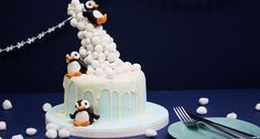 We love penguins and we love Cadbury Snowballs, so naturally, we had to find a way to combine these two elements - say hello to our Snowball gravity cake! Christmas Cake Designs, Christmas Cake Decorations, Christmas Cakes, Christmas Ideas, Xmas, Anti Gravity Cake, Gravity Defying Cake, Penguin Cakes, Penguin Party