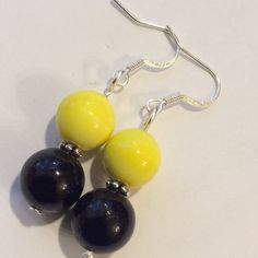 SUPER SALE  Black & Yellow Earrings Black & Yellow Beaded Earrings...beads separated by s small silver spacer!! Jewelry Earrings