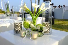 The Legian Resort in Bali, hosts a beach side wedding. Table decorations include white calalillies, soft mint green hydrangea, and Natural Light Damask Pillars in black & White. Love the white ribbon with black stiching.