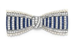 AN ART DECO DIAMOND, SAPPHIRE AND PEARL BOW BROOCH, BY TIFFANY & CO. – Christie's Designed as an old European and square-cut sapphire bow in a step-like pattern, with an old European-cut diamond pierced knot, trimmed by single and old European-cut diamonds and pearls, mounted in platinum, circa 1920