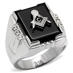 Description: Perfect for the stylish man who wants to make a bold statement, this handsome Masonic ring is the perfect choice. A bed of black metal highlights a stylish rectangular Masonic logo measuring 16mm by 12mm is embellished with top of the line cubic zirconia stones and rendered in a stainless steel band. Stainless steel jewelry is durable and does not tarnish. Not only is stainless steel one of the strongest metals...