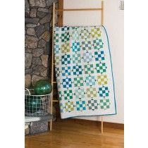 Like a collection of blue and green sea glass, this quilt shines in a repeated block pattern by Romona Sorensen. Sea Glass Quilt Pattern