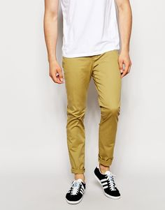 """Pants by ASOS Woven cotton Stretch added for comfort Zip fly with button fastening Side pockets and two back pockets Skinny fit - cut closely to the body Machine wash 98% Cotton, 2% Elastane Our model wears a 32""""/81 cm regular and is 188cm/6'2"""" tall"""