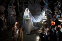 Meghan Markle walks down the aisle, 2018. Photo by Danny Lawson / AP. Wedding dress by British designer Clare Waight Keller of Givenchy.