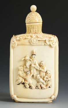 """Carved Ivory Snuff Bottle. Straight sided with rounded shoulders, with figures and flowers. Ht. 3 3/4"""""""