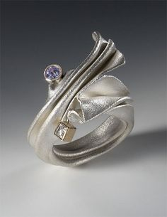 "Ring | Nick Grant Barnes.  ""Wave IV"".  18K Gold, cubic zirconia. Fabricated, fold formed"