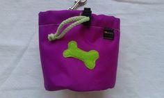 Fuchsia dog treat bag with a bone motif by DoGATAilla on Etsy