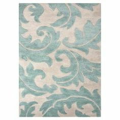 Hand-tufted wool and art silk rug with a blue acanthus leaf motif.   Product: RugConstruction Material: 70% Wool and 30% art silkColor: Ivory and blueFeatures: Part of the Blue CollectionTransitional styleTextured with a floral pattern  Dimensions: 5' x 8'Note: Please be aware that actual colors may vary from those shown on your screen. Accent rugs may also not show the entire pattern that the corresponding area rugs have.Cleaning and Care: Professional cleaning recommended