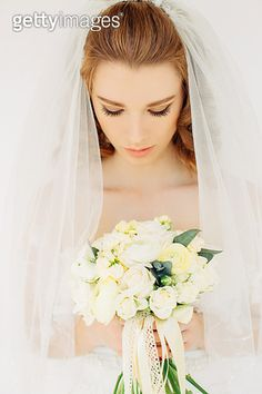 Portrait of a fresh and lovely bride wearing veil - gettyimageskorea
