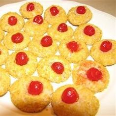 Evelyn's Cornflake Cookies - really an almond-flavored cream cheese cookie rolled in crushed cornflakes and garnished with a cherry.
