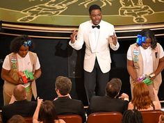 Chris Rock just sold Girl Scout cookies at the Academy Awards, so he's pretty much Dad of the Year