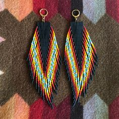 These OOAK handwoven beaded earrings with fringe are made with Japanese seed + bugle beads, raw brass rondelles, finished with gold filled ear. Seed Bead Jewelry, Seed Bead Earrings, Fringe Earrings, Diy Earrings, Earrings Handmade, Beaded Jewelry, Handmade Jewelry, Gold Earrings, Jewellery