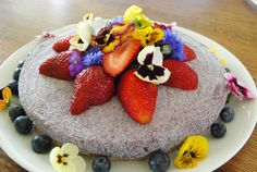 Raw blueberry cheesecake for paleo wedding. Gluten free, dairy free and cane sugar free. And all those flowers are edible!