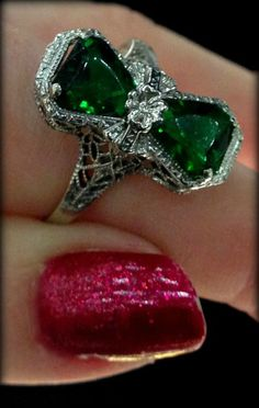 Antique Art Deco green stone and filigree ring with flower detail. Via Diamond in the Library.