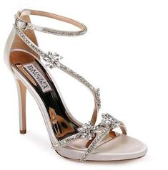 Badgley Mischka Hodge strappy sandal for women. Shimmering crystals amp up the glamour of a leg-lengthening evening sandal secured by an adjustable strap at the ankle.