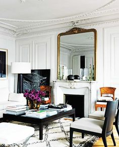 gilded mirror, Moroccan rug, coffee table styling, Paris apartment