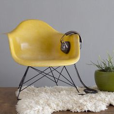Eames cats cradle chair in the best color ever!  From Atomic Age Accents