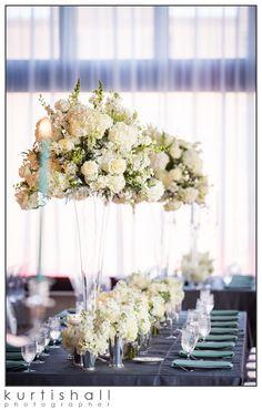 Long tables with multiple flower arrangements!