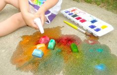 Ice chalk.  Freeze baking soda, corn starch, liquid water colors, and water.  Spray with vinegar for fun.