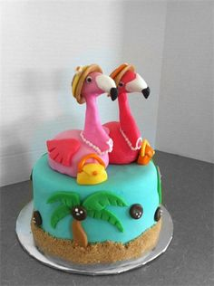 "This is the one I was talking about Jaci............Lady Flamingos Cake  : 6"" 2-layer white cake covered in teal fondant with ricecrispie flamingos on top, brown sugar sand & fondant accents"