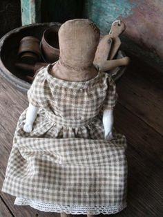 Schneeman. I LOVE  Schneeman cloth dolls, their truly yesteryear<she makes awesome dolls.