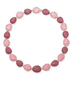 A PINK SAPPHIRE AND RUBY 'PEBBLE' NECKLACE  Composed of alternating pavé-set pink sapphire and ruby pebble links to the diamond clasp, mounted in 18k pink, blackened and white gold, 42.0 cm long, with suede pouch Stamped Mdv for Michele della Valle