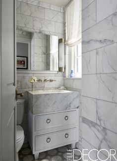 Add marble to any small bathroom to make a huge (and chic!) statement.