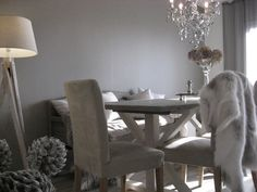 dining room dining table gray white wood greige chandelier