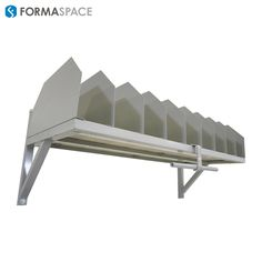 Infinitely Adjustable Dividers | FORMASPACE | Top of highly customized packing station for largest e-tailer.