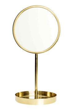 Round table mirror: Small table mirror in glass with a metal frame and round metal foot with a padded base. Diameter of mirror 12 cm, height 26 cm.
