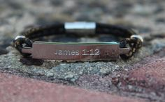 "James 1:12 New International Version (NIV)The word of GOD says...""Blessed is the one who perseveres under trial because, having stood the test, that person will receive the crown of life that the Lord has promised to those who love him.""This unisex bracelet comes in both stainless steel silver and 18k plated gold. Plate weighs just over 7 grams, it's one size fits all and closes with a magnetic clasp. This design exudes sophistication, simplicity and is perfe..."